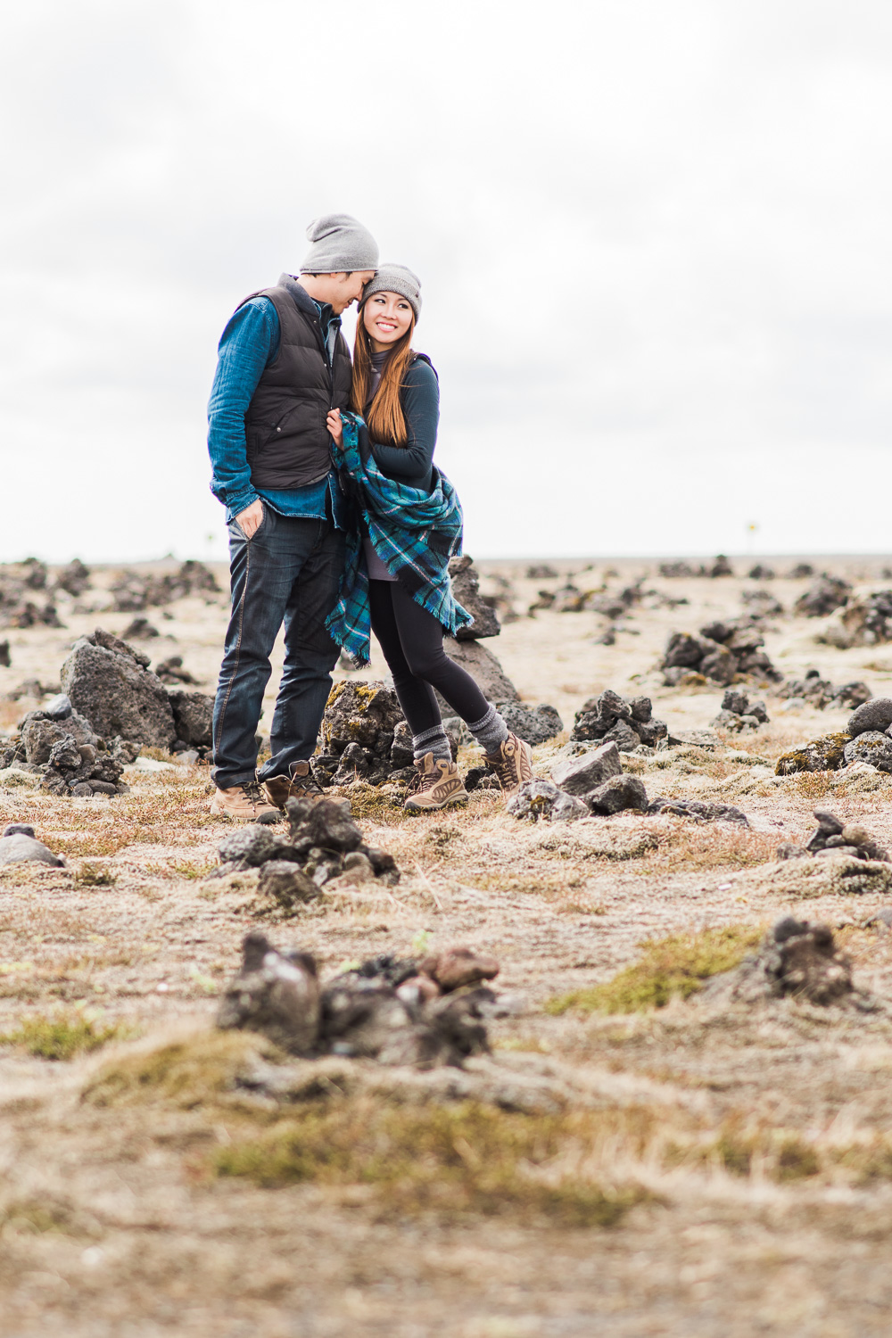 Tracey and Bi standing in lava field in Iceland