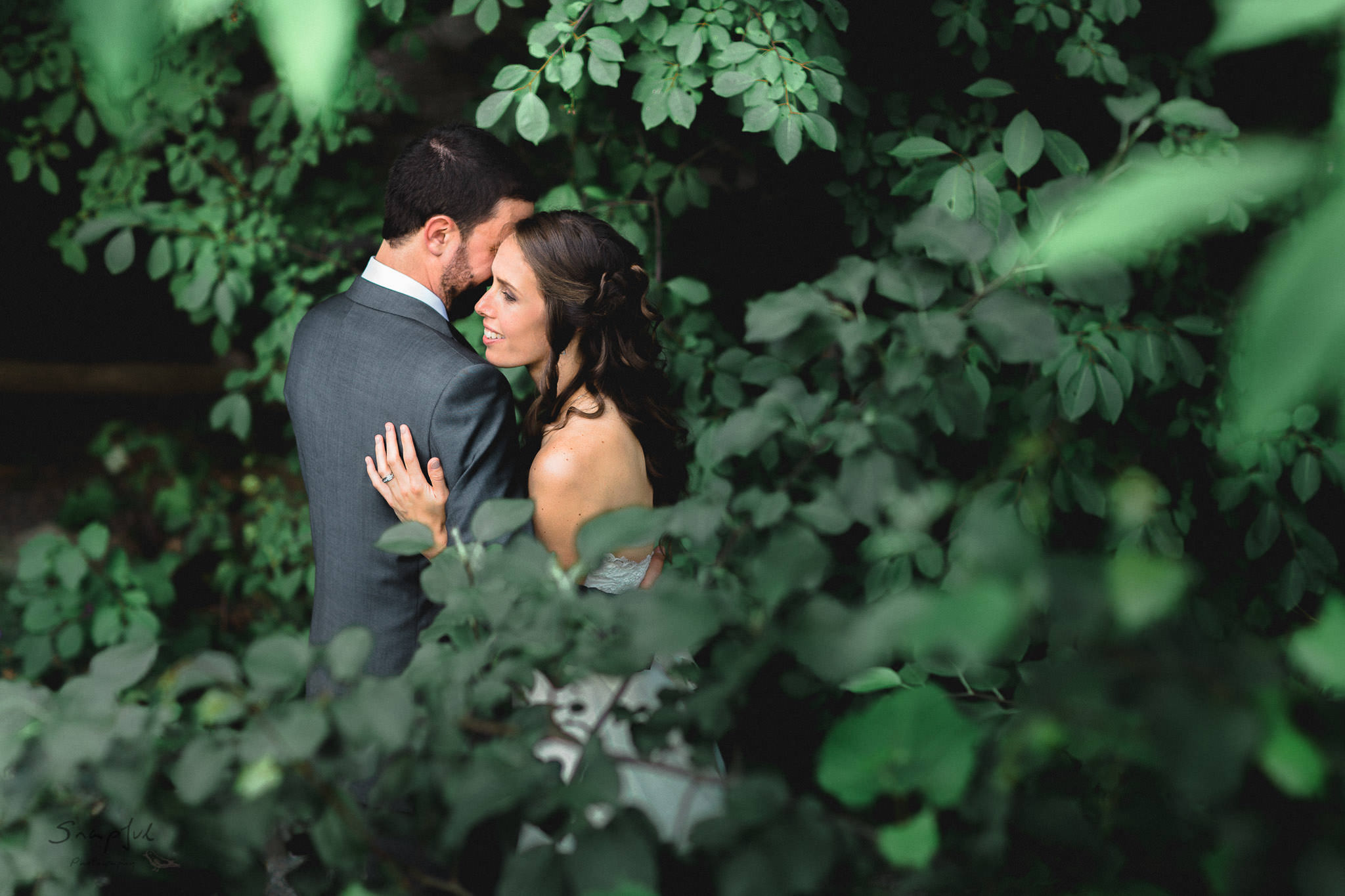 Bride and groom share a moment in the forrest at Alton Mill