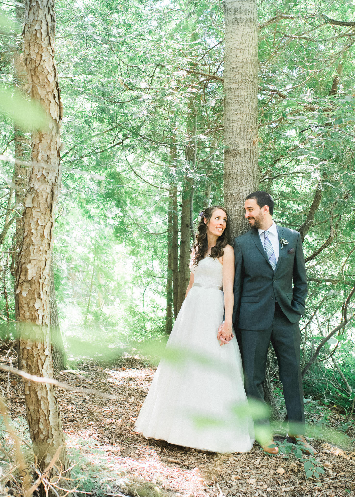 Bride and groom pose in the forrest at Alton Mill