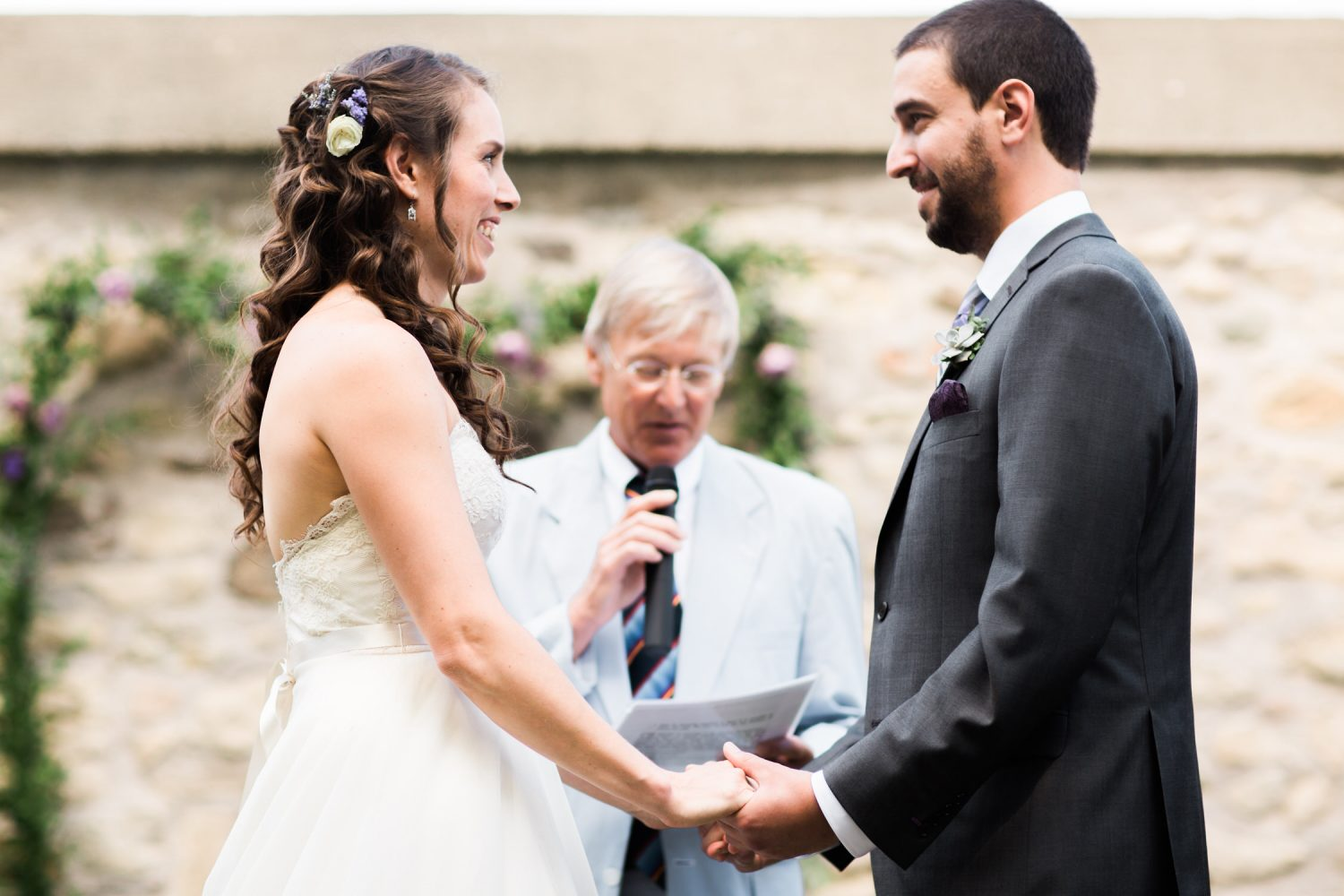 Bride and groom exchange vows during ceremony at Alton Mill