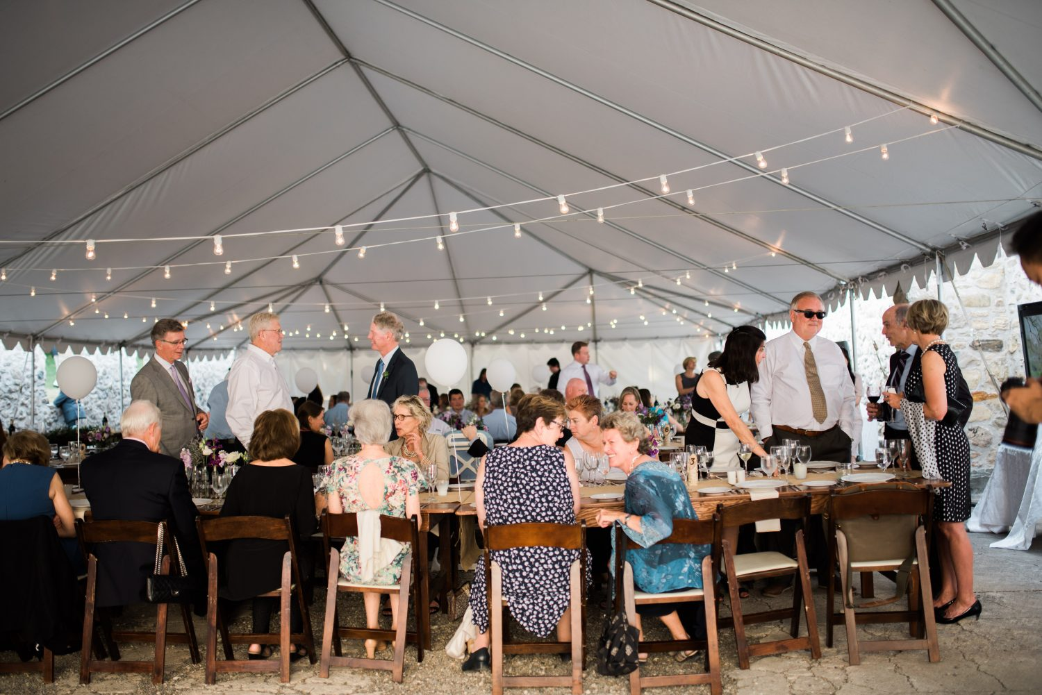 Guests sit down for wedding dinner at Alton Mill