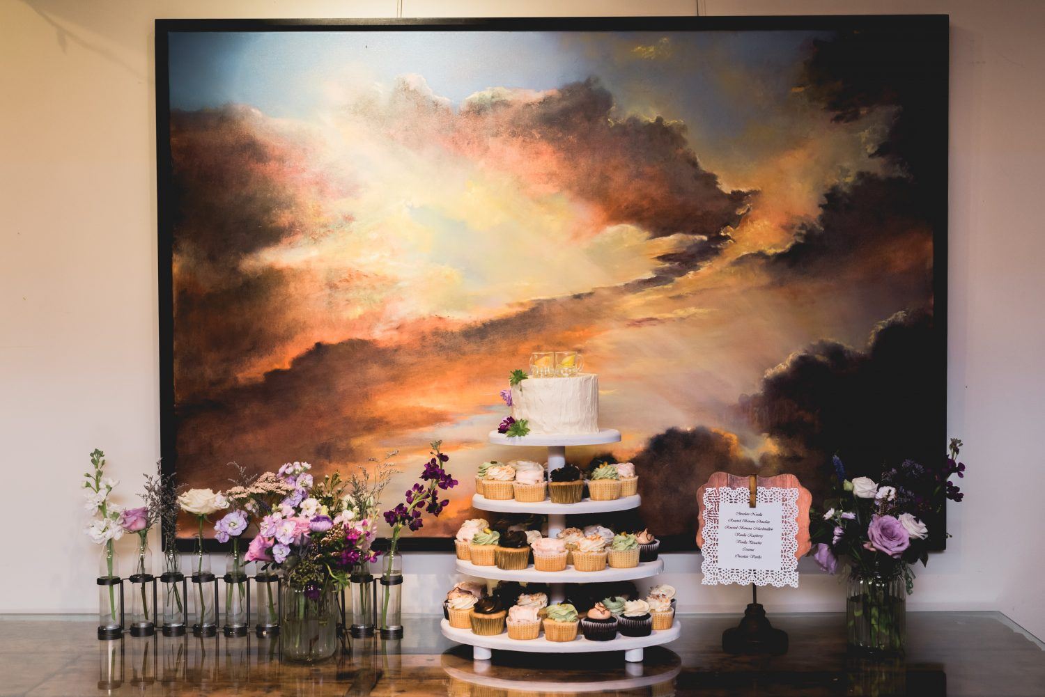 Cupcakes in front of beautiful painting at Alton Mill wedding