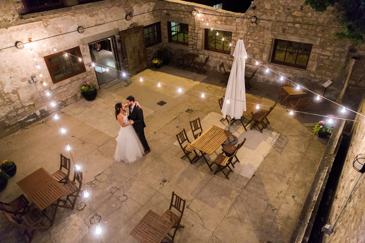Bride and groom dancing alone in the courtyard at Alton Mill