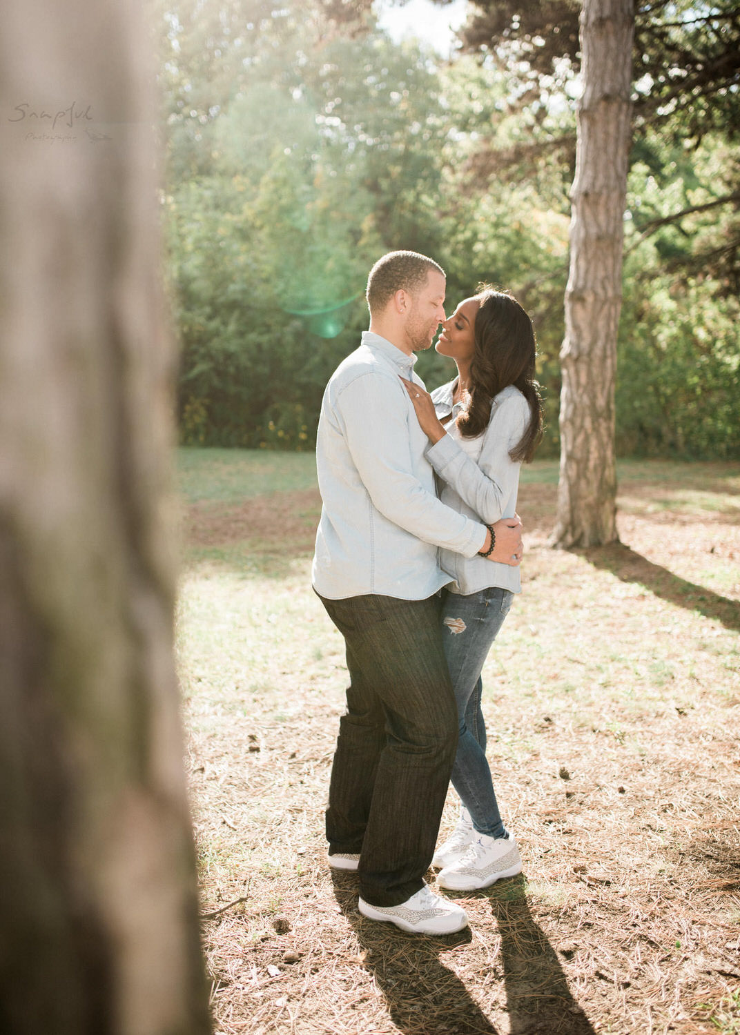 Couple sharing a kiss during engagement session at High Park Toronto