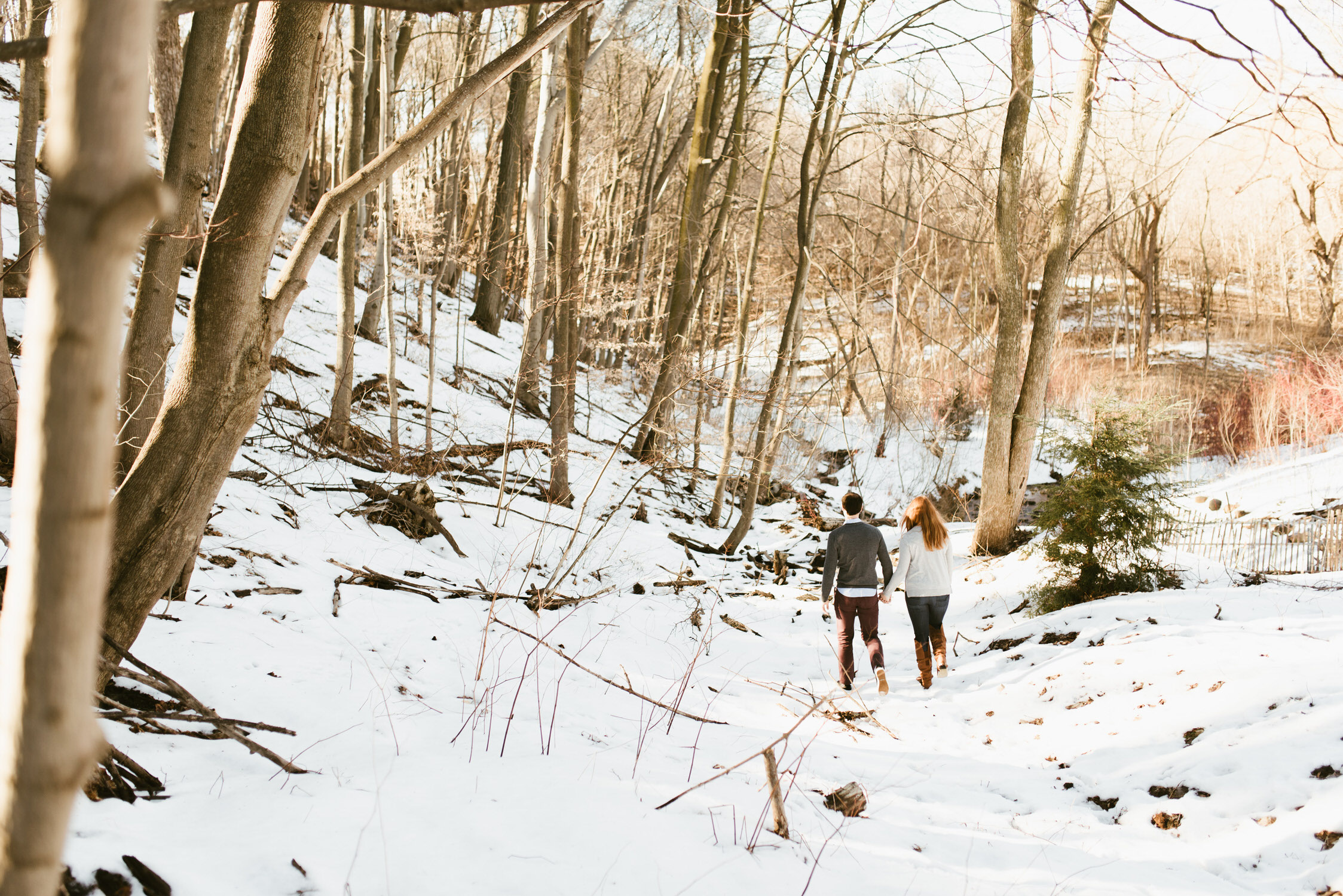 Isabel and Matt walking into a snowy area of Evergreen Brickworks