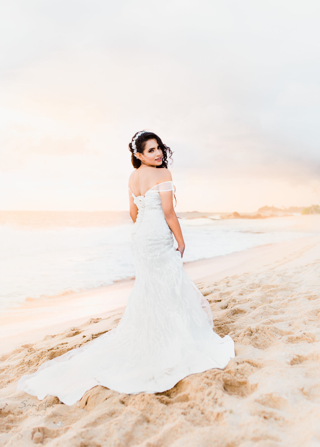 Stunning bride poses at sunset on Sri Lankan beach