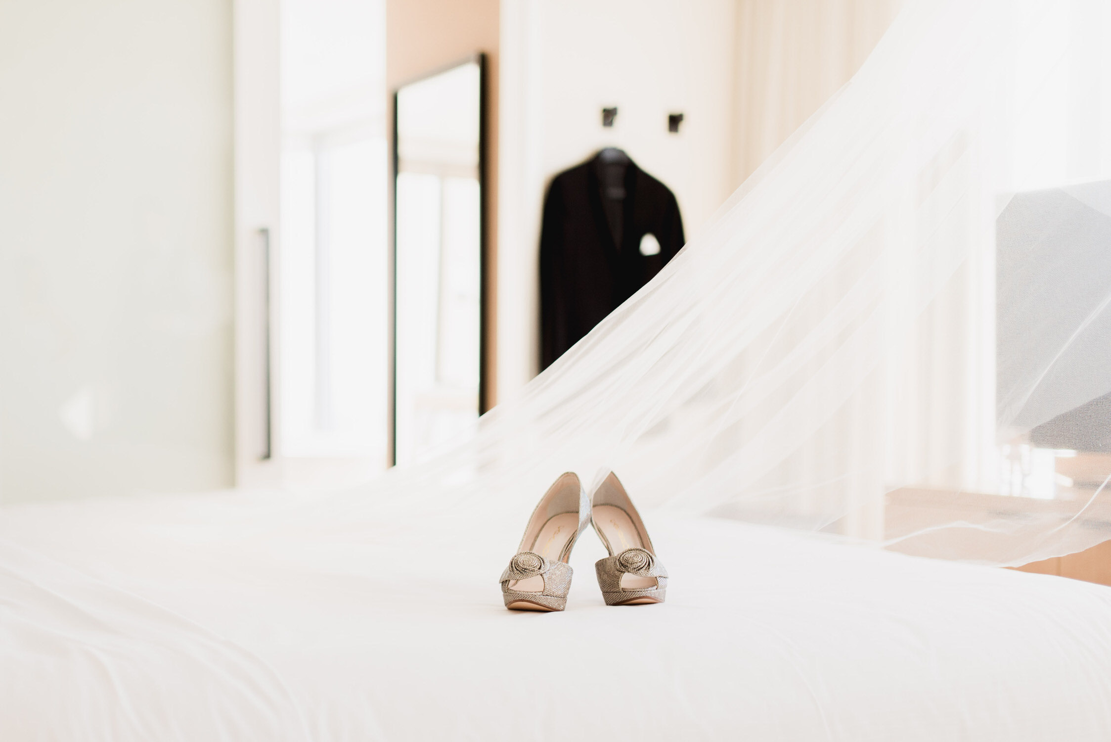 photograph of bride's shoes on bed at Delta Hotel in Toronto