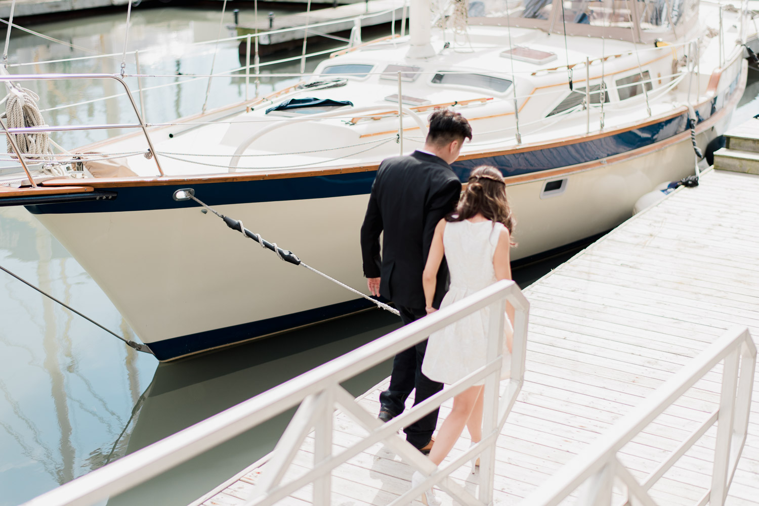 Couple walking down ramp at harbourfront Toronto during an engagement session with Snapful Photography