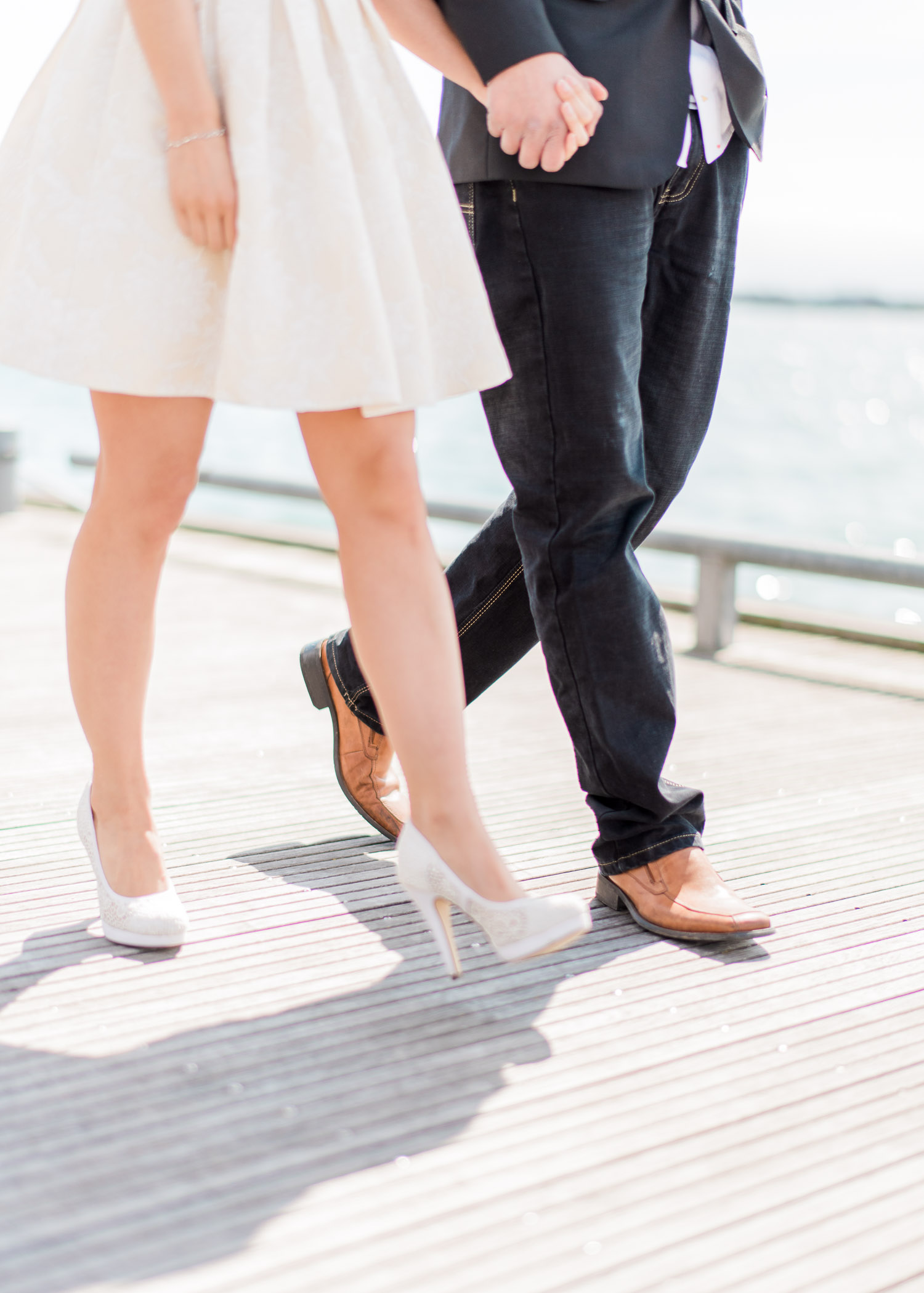 Close shot of the couple's shoes at Harbourfront Toronto