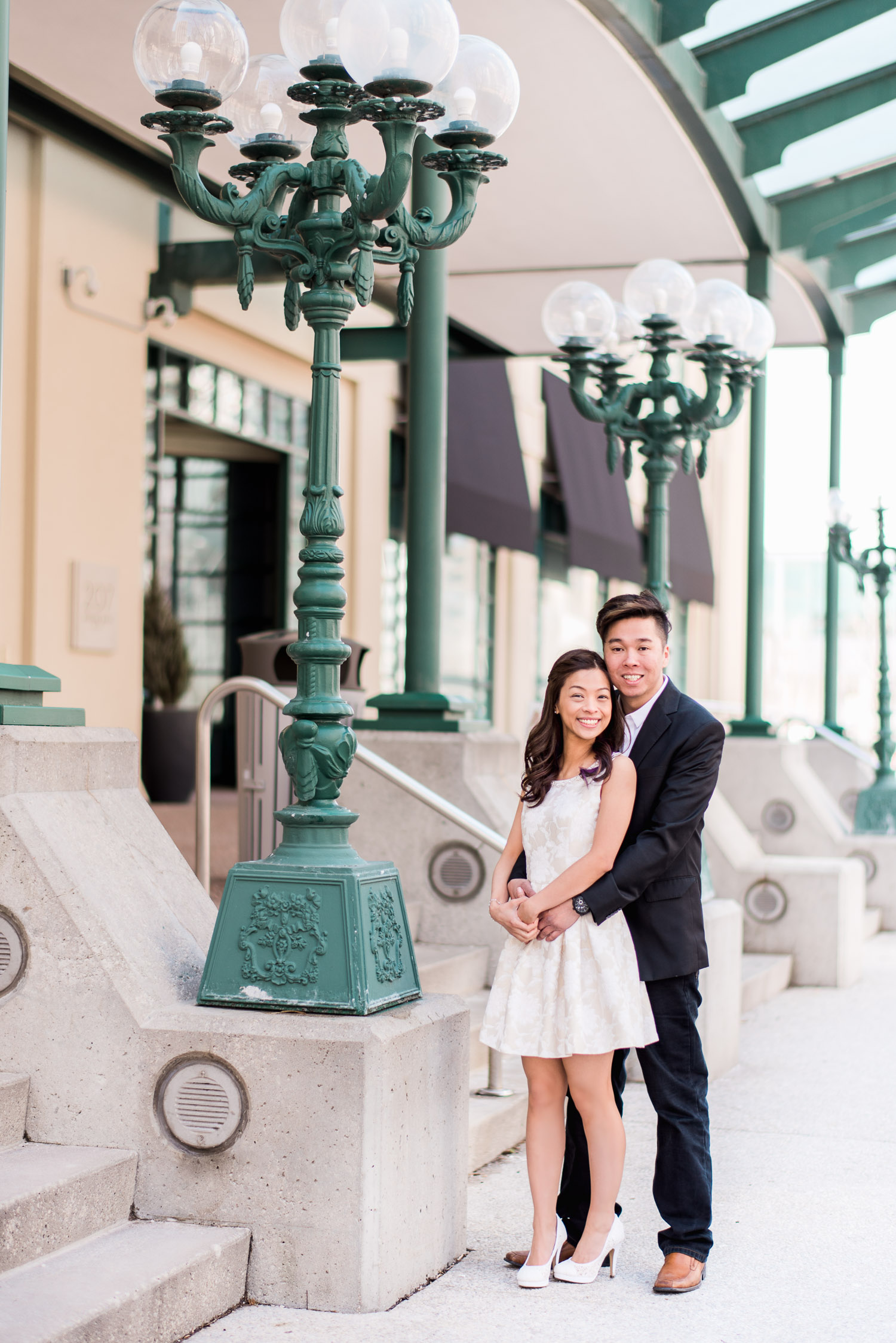Couple staring at camera at Harbourfront during engagement shoot with Snapful