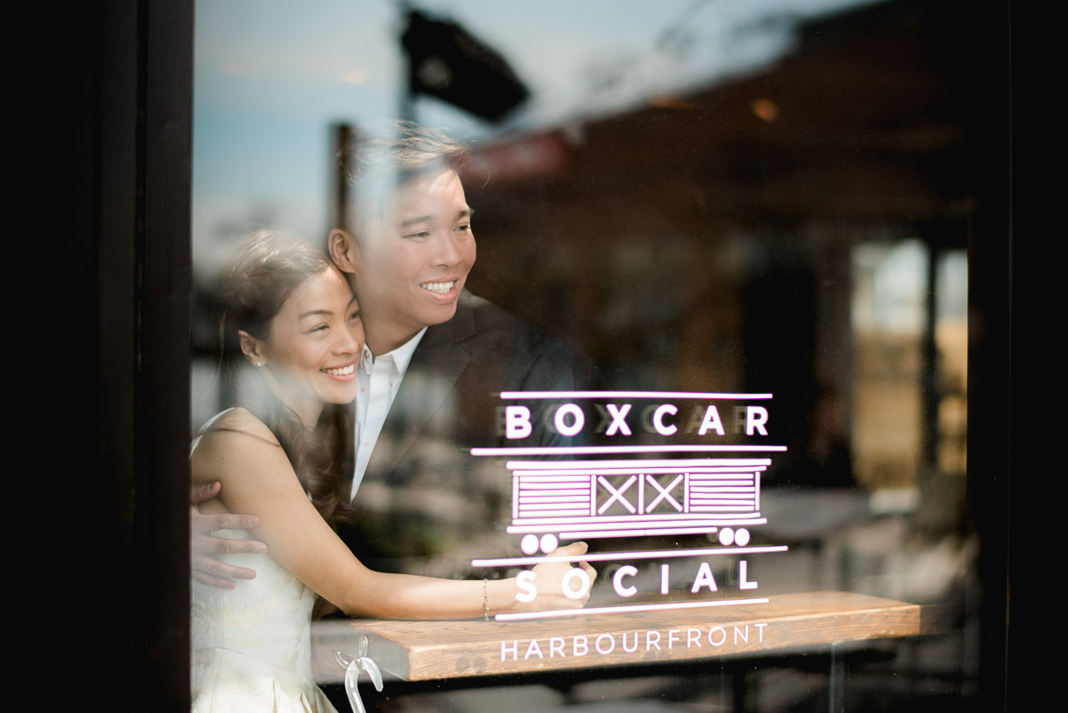 A photograph taken outside window of the couple of Boxcar Social in Toronto at Harbourfront