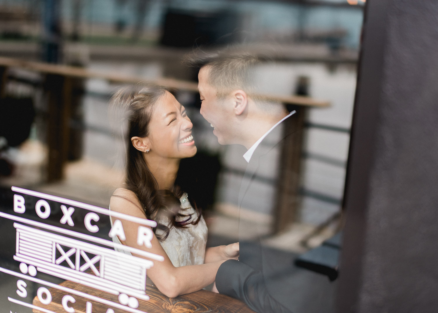 Cute photo of couple through window at Boxcar Social at Harbroufront Toronto