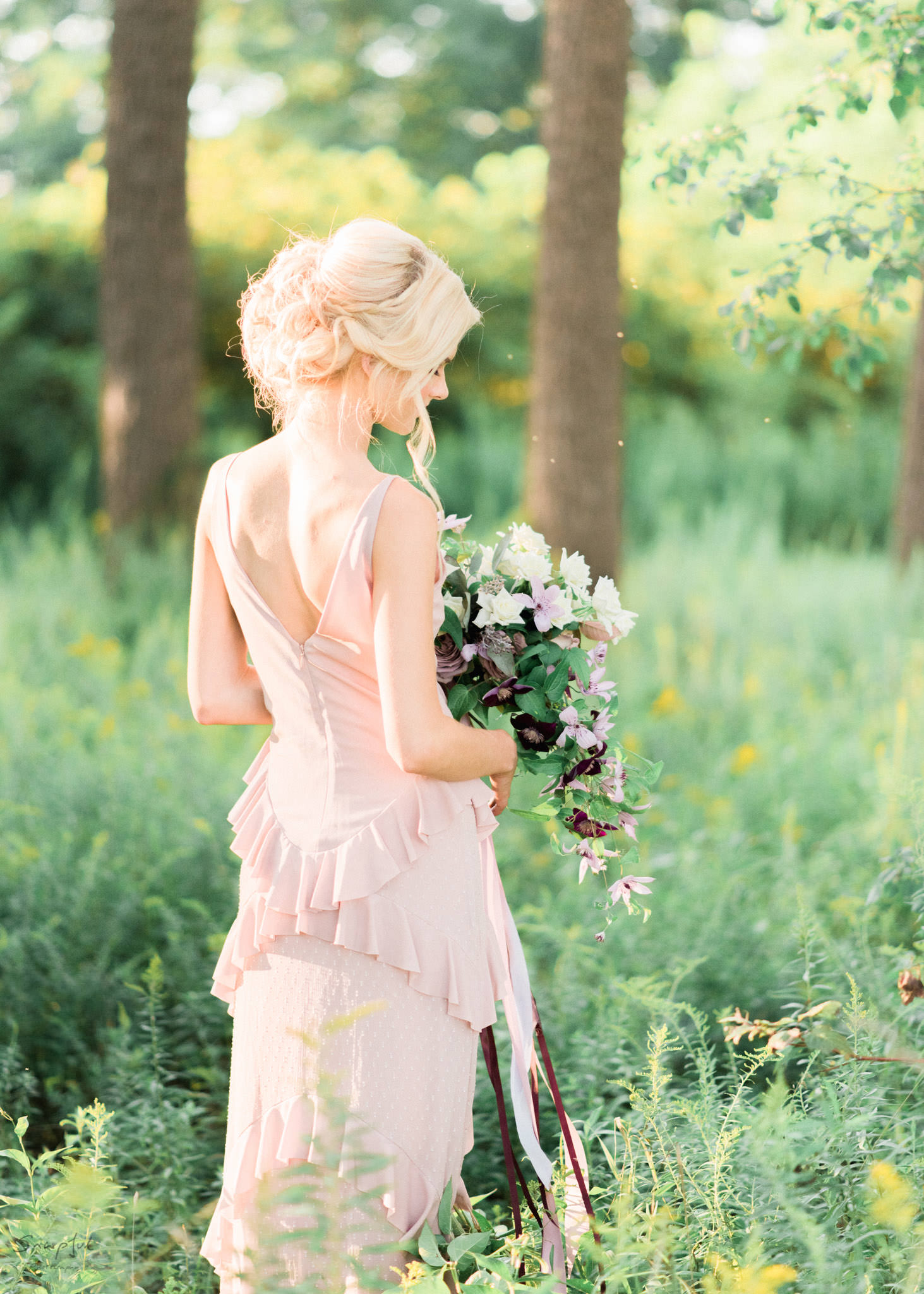 Back shot of bride with bouquet