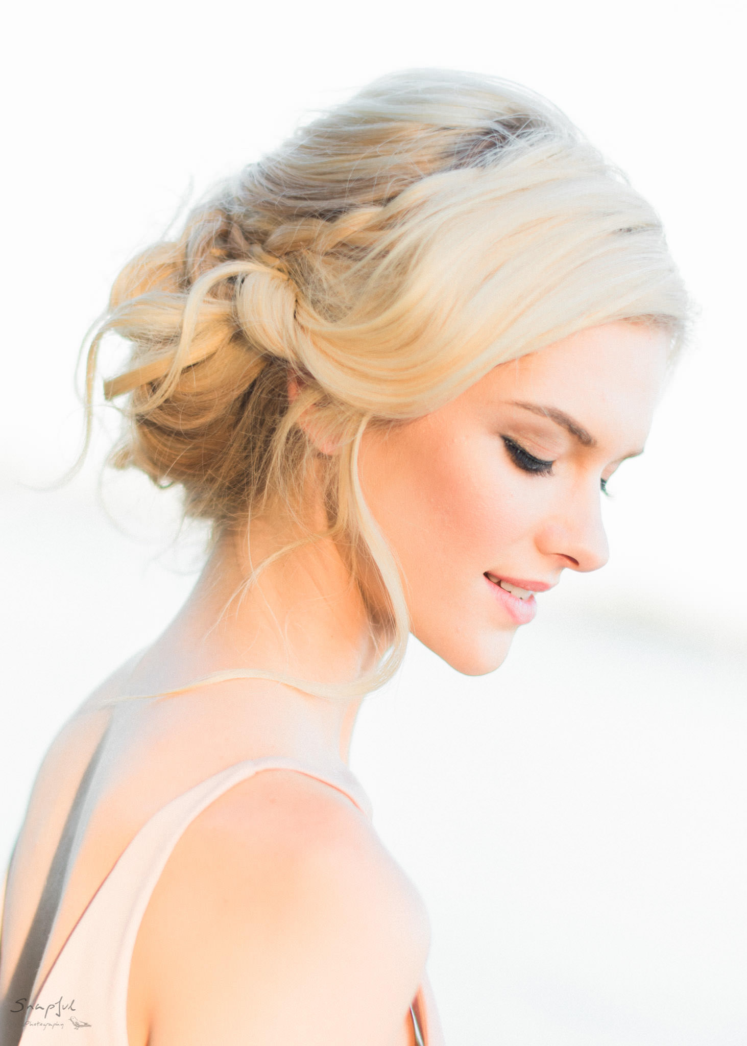 Portrait of beautiful bride at sunset