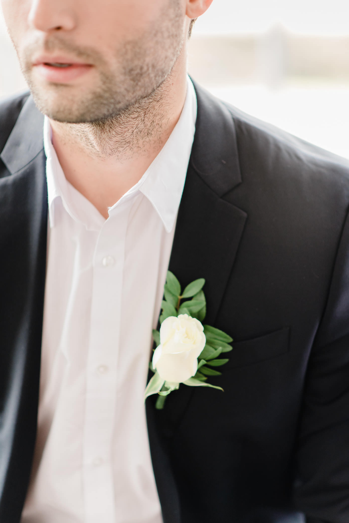 Close up shoot of boutonniere on groom at the Estates of Sunnybrook