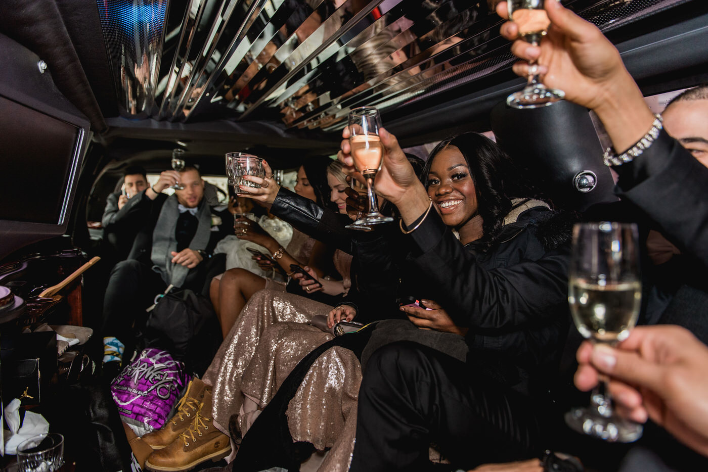 Wedding party toast inside limo in Toronto