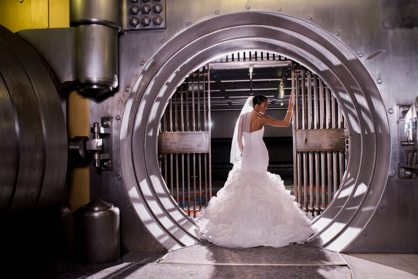 Epic bride poses inside vault at One King West Hotel