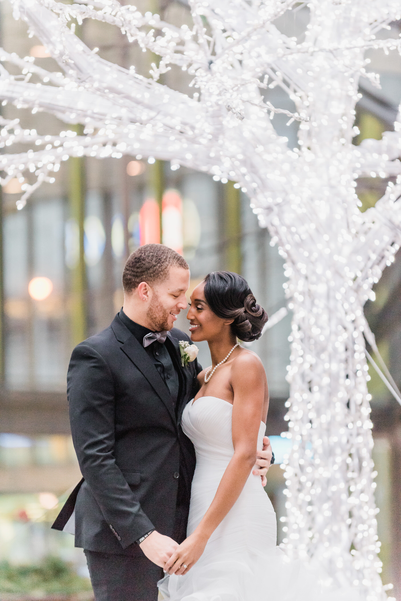 Light and airy portrait of couple in downtown Toronto for New Year's eve wedding