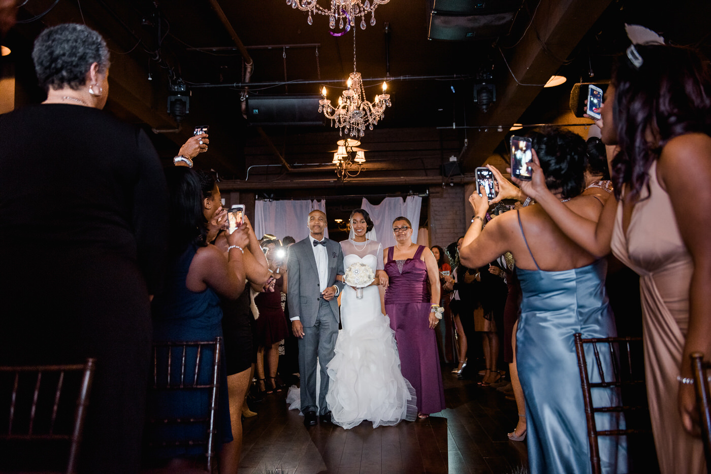 Parents walk bride down the aisle at New Year's Eve wedding in Toronto