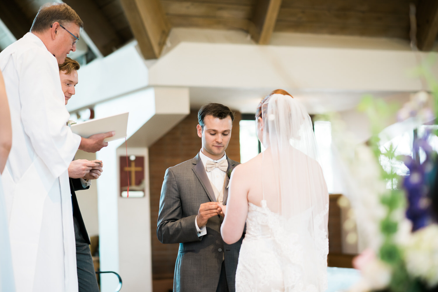 Bride and groom exchanging rings in Toronto