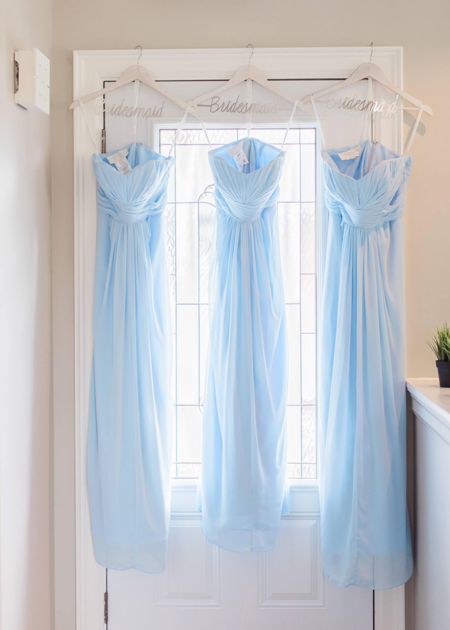 bridesmaids' dresses hanging on door