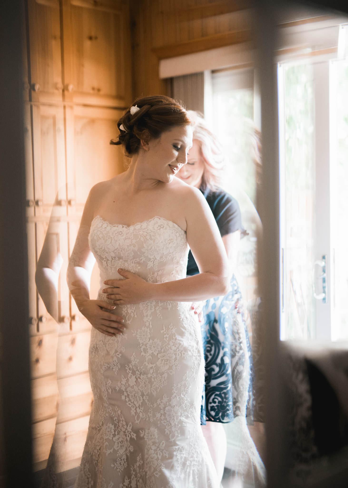 Mom zipping dress for bride