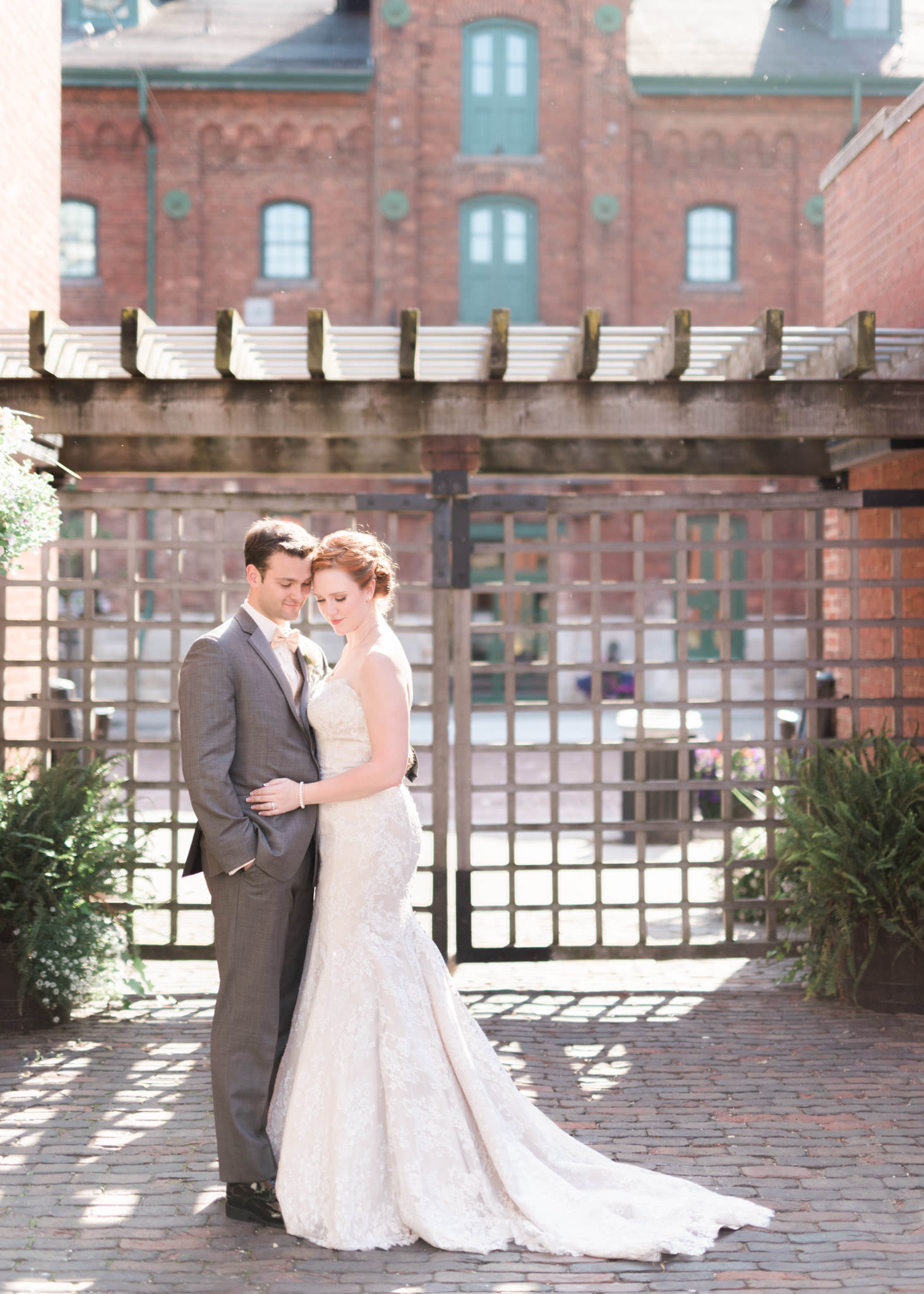 Groom and bride share a moment at Archeo wedding in Distillery District in Toronto