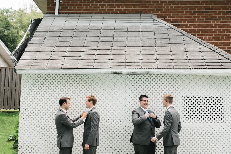 Groomsmen fixing each other's ties