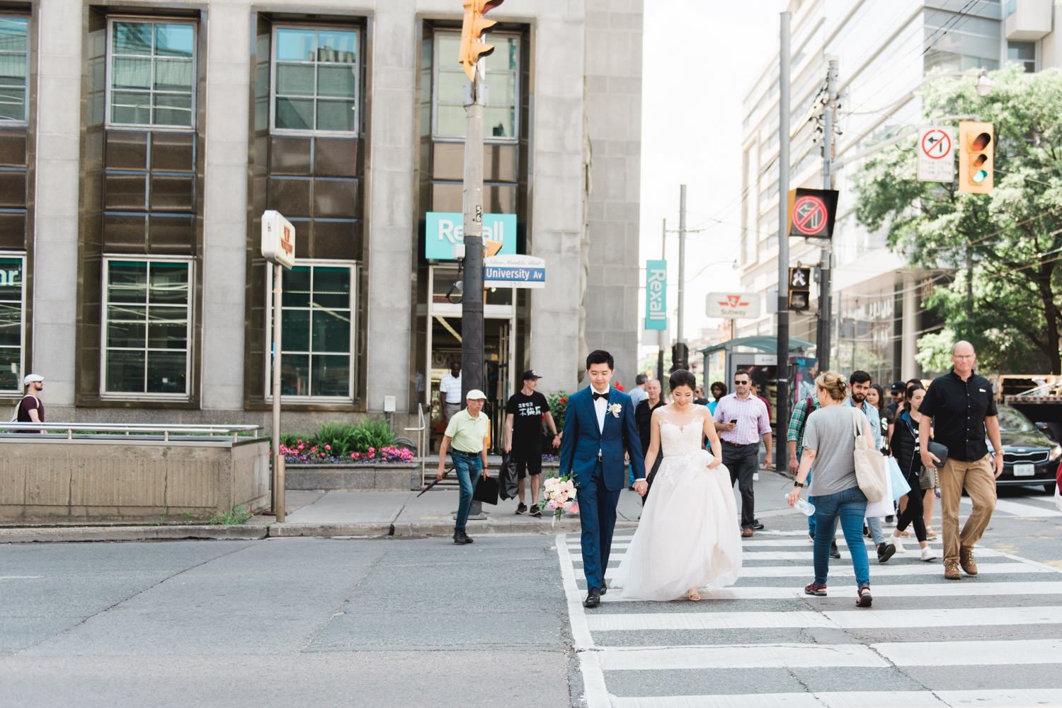 Bride and groom walking in the streets of downtown Toronto