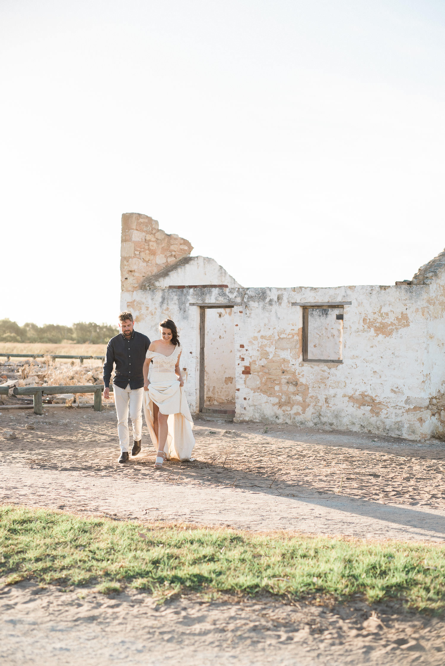 Bride and groom walking way during elopement at Perry's Paddock in Perth