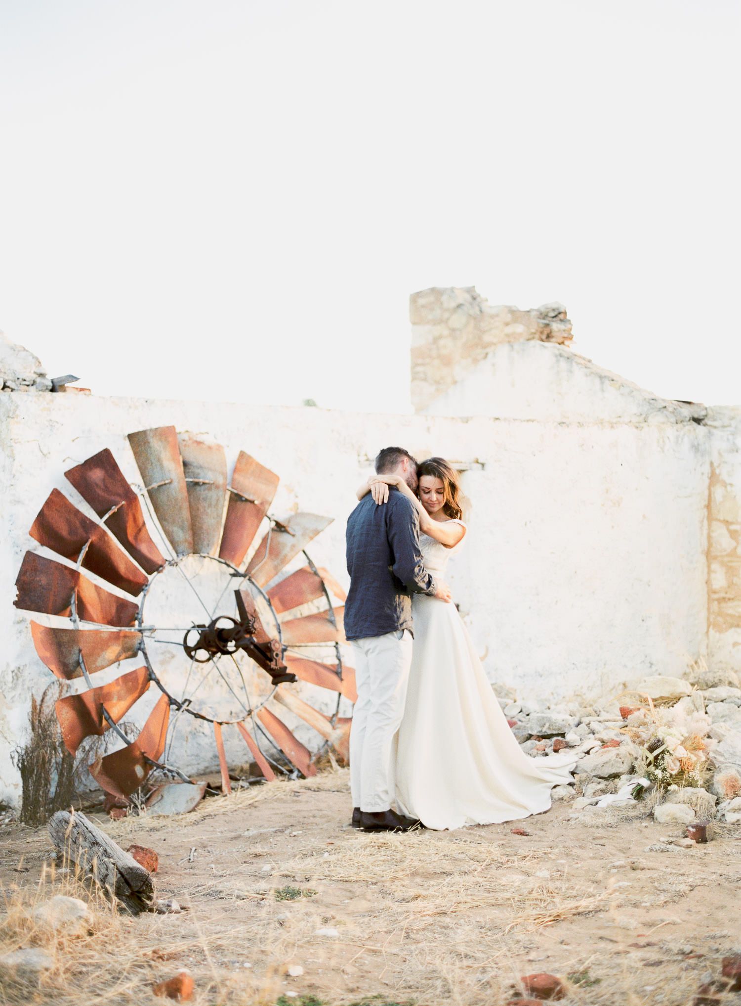 Lovely couple pose in front of Perry's Paddock wedding in Perth