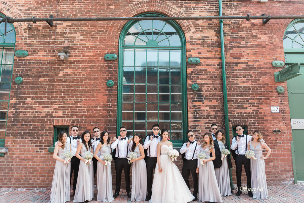 wedding party striking a pose at Distillery District