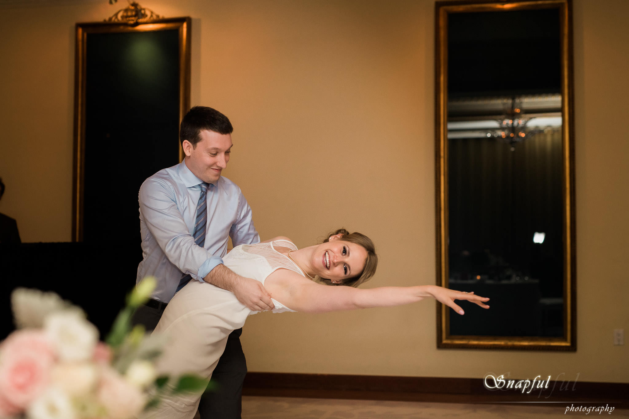Groom and bride showing off dance moves