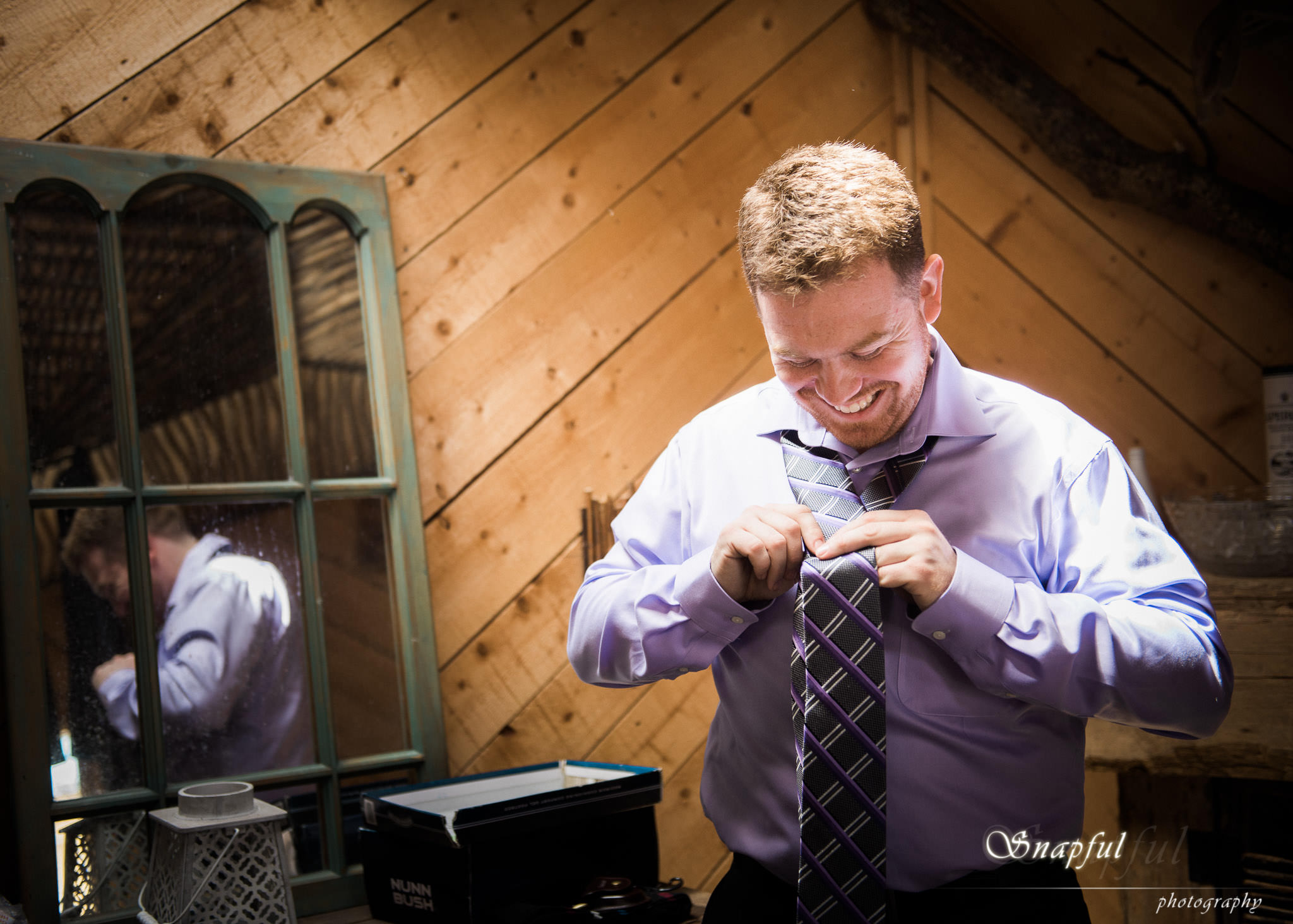 Groom getting ready in a treehouse