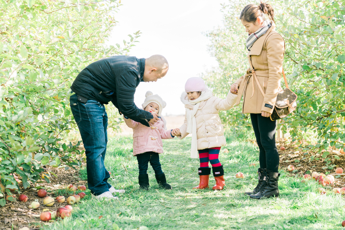 Family tasting apple at the farm