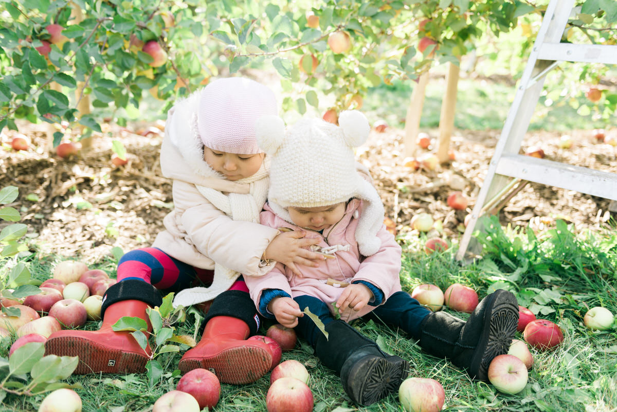 sisters playing with apples