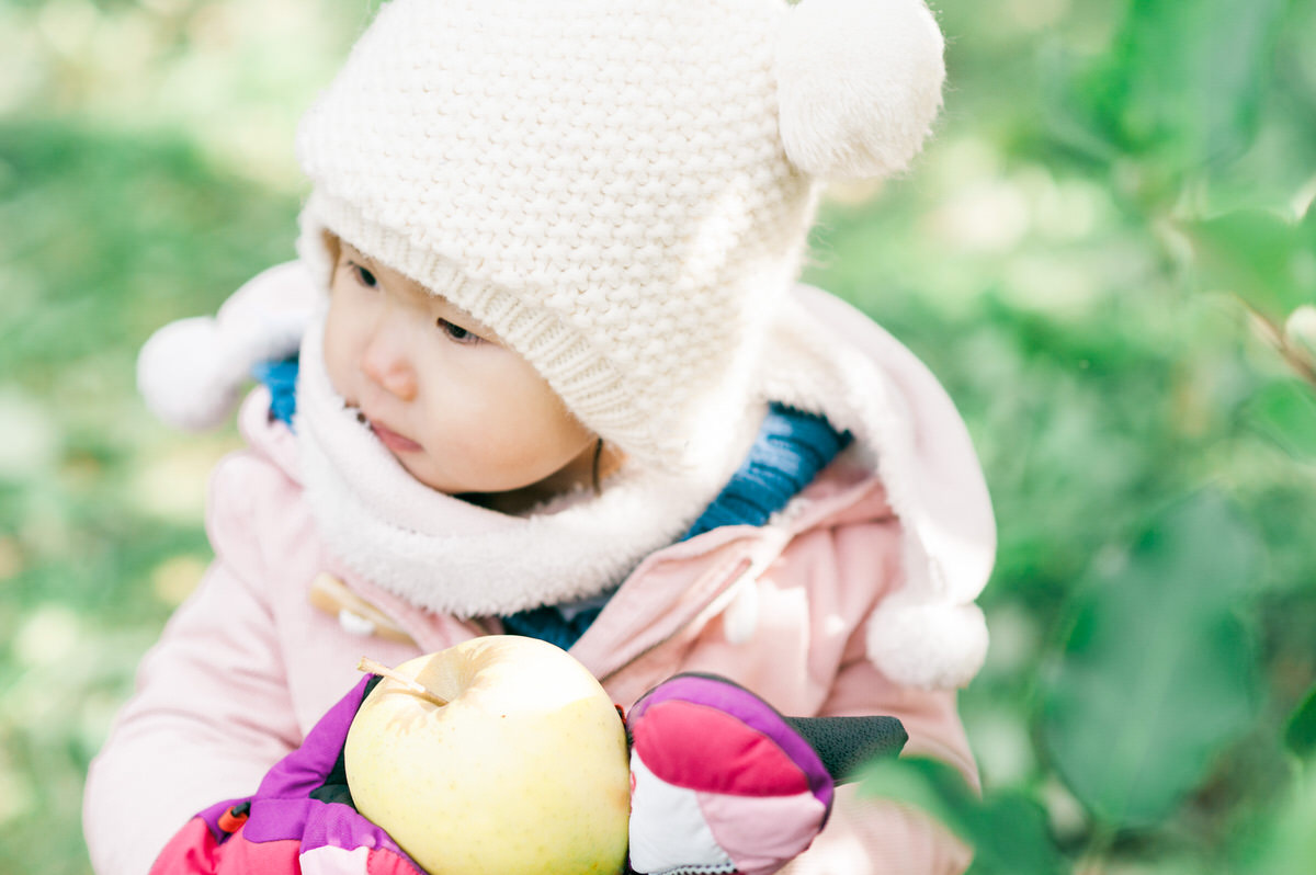 Child holding a delicious apple