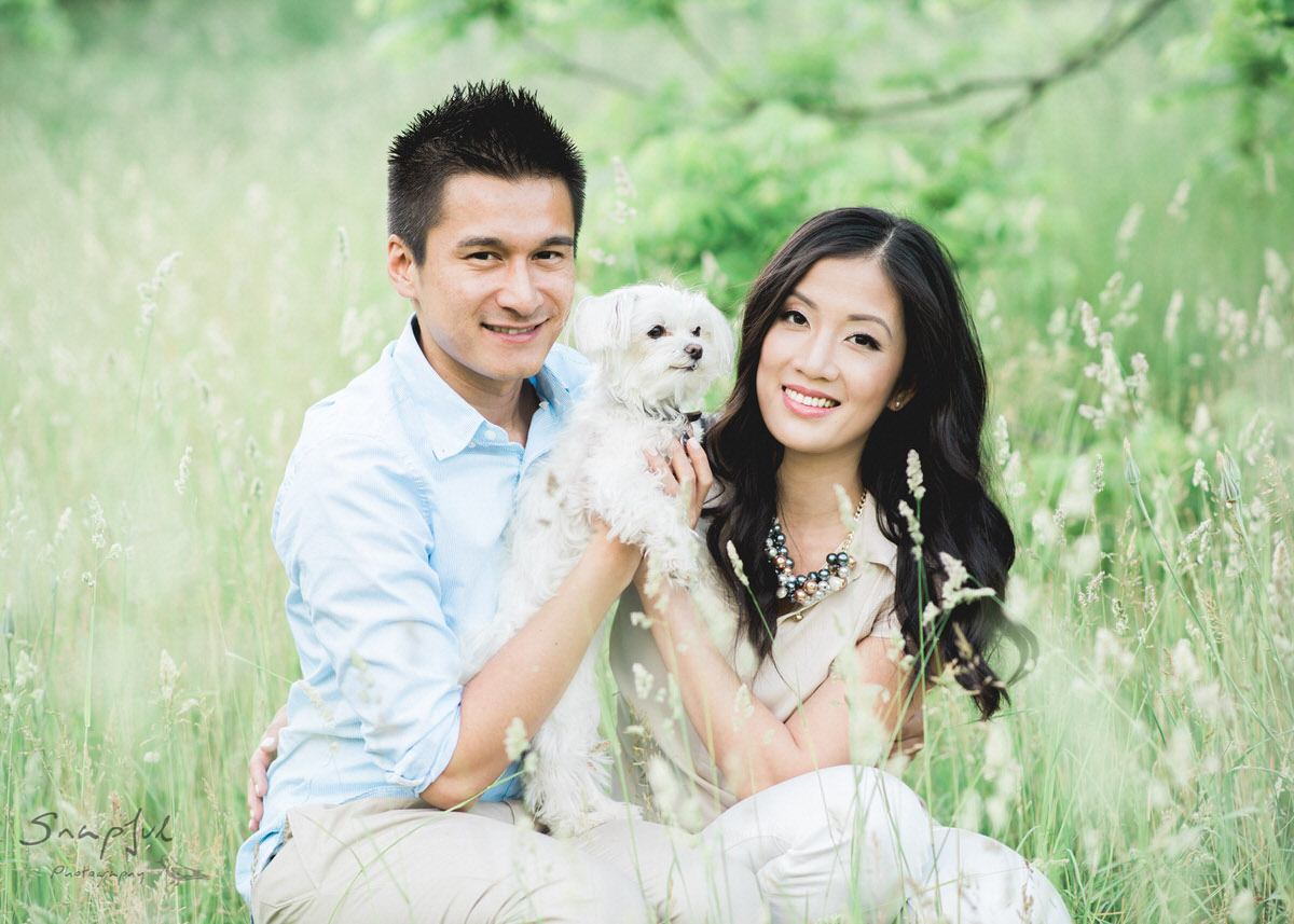 Couple posing with their cute dog