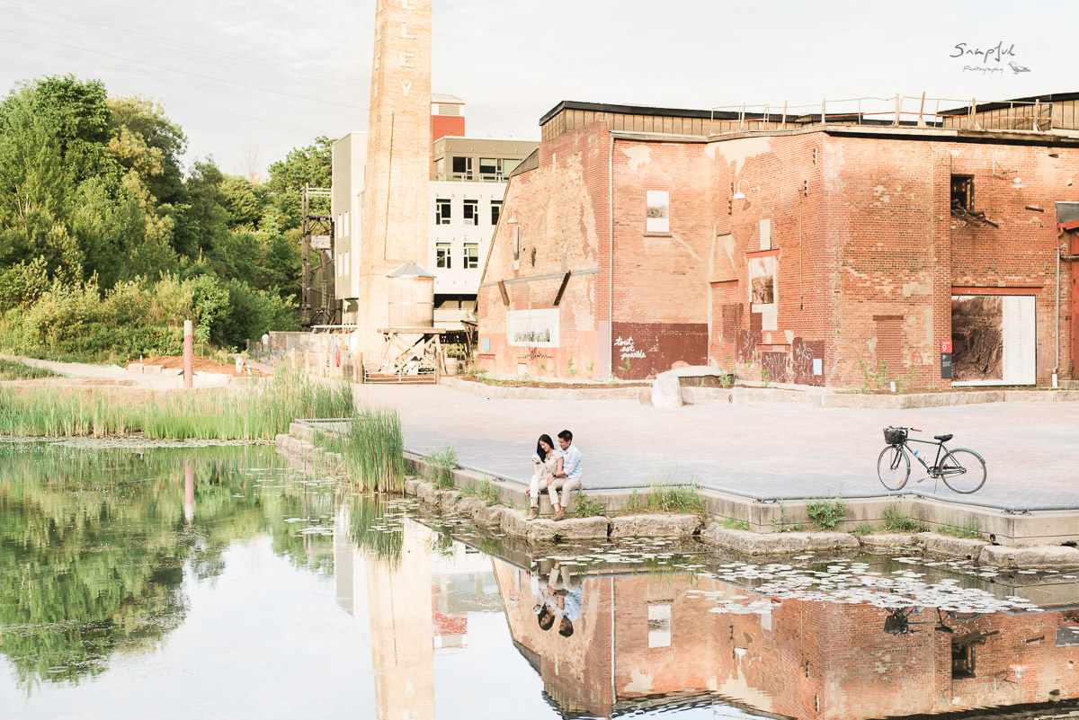 Couple sitting by the pond at Evergreen Brickworks