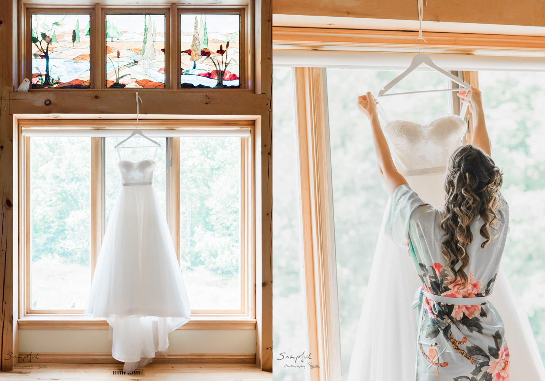 Bride reaching for her wedding dress