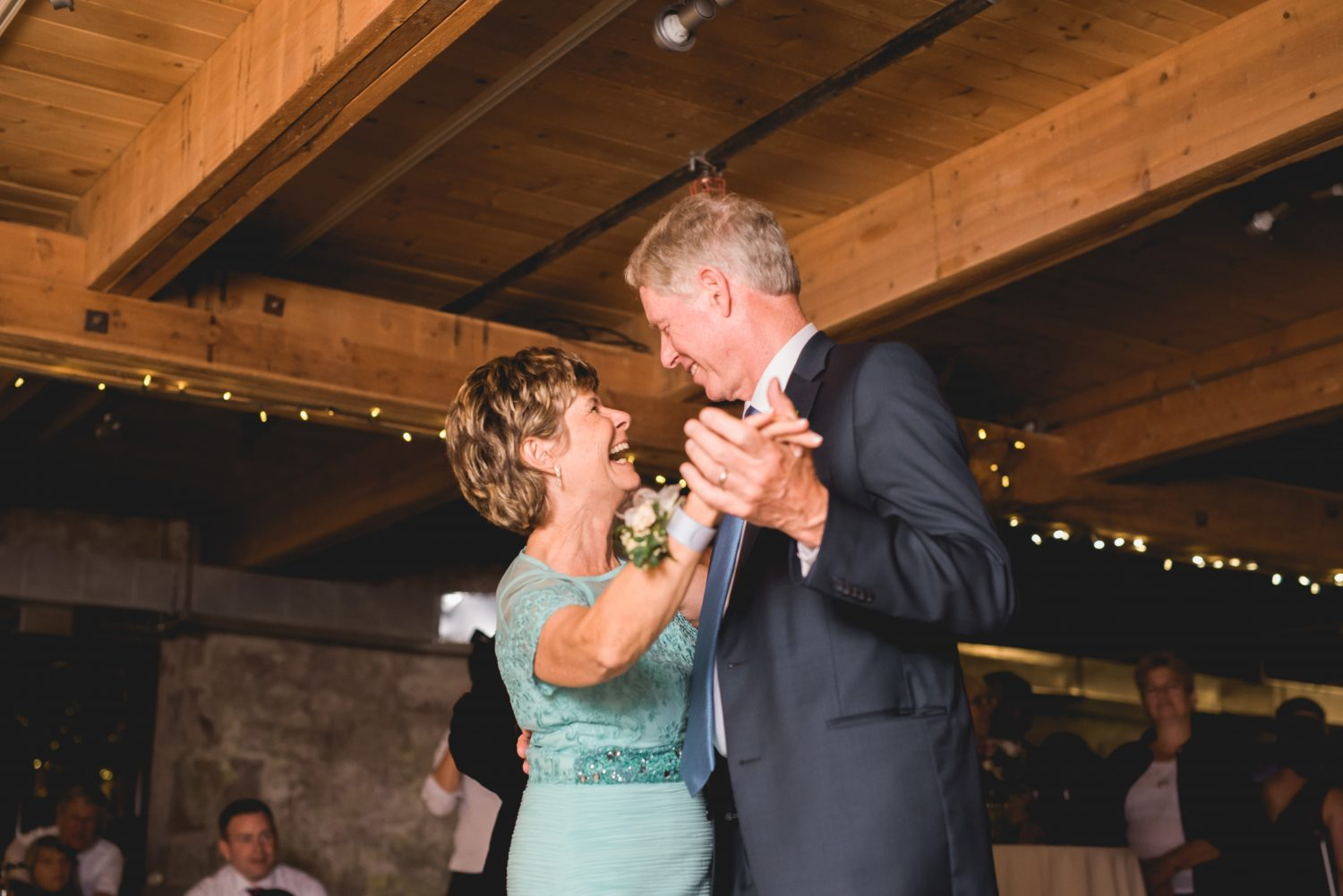 Father and mother of bride slow dance at Alton Mill wedding