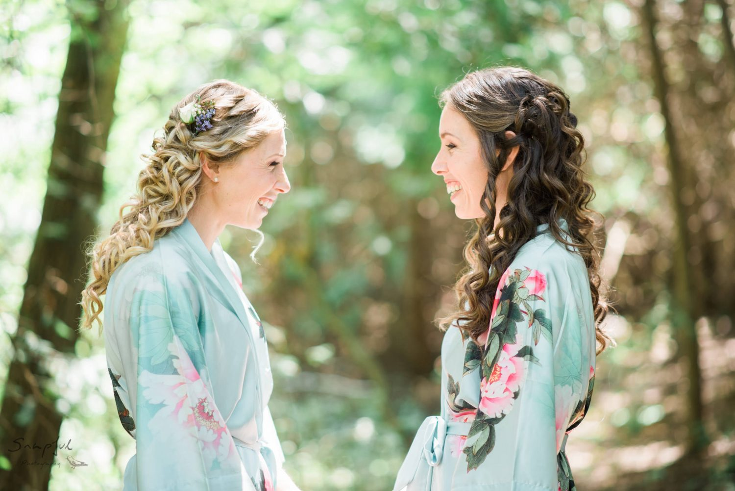 Sisters share an intimate moment in the forest