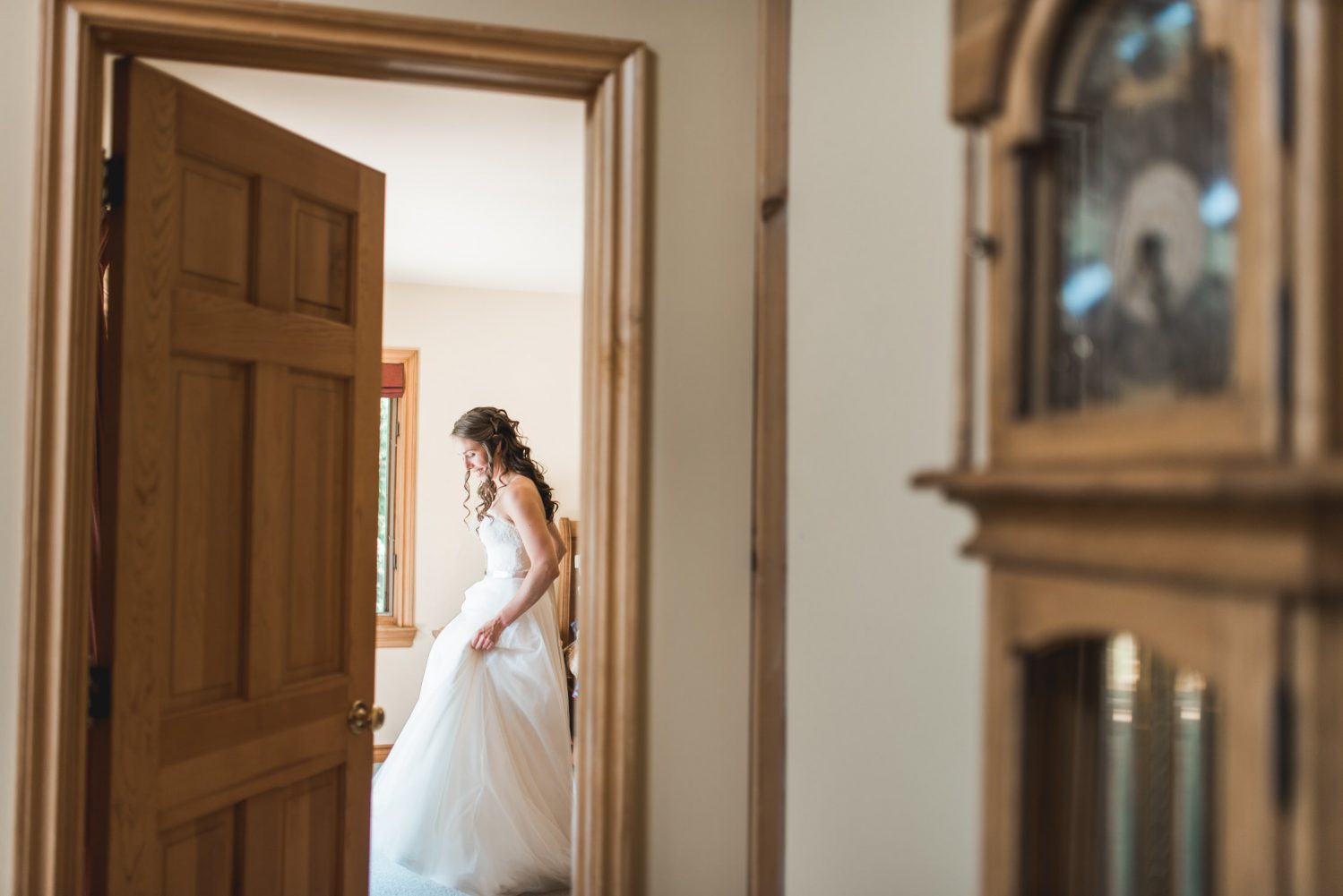 an intimate view through doorway of bride