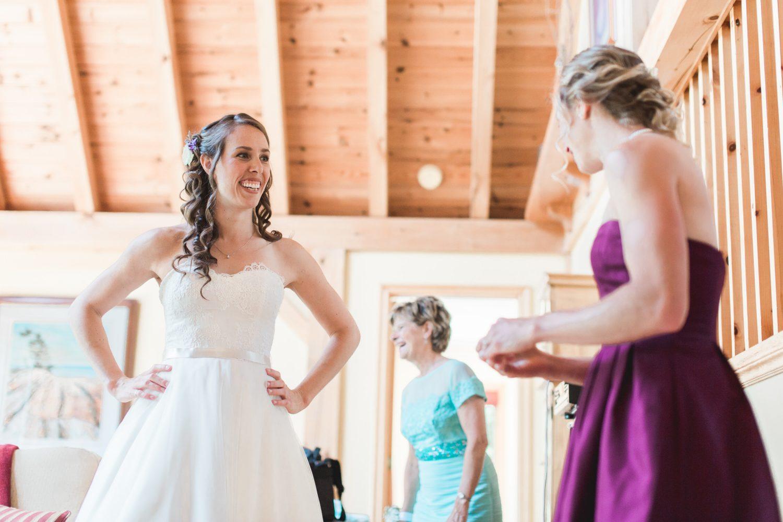 Sarah showing her bridesmaid her dress