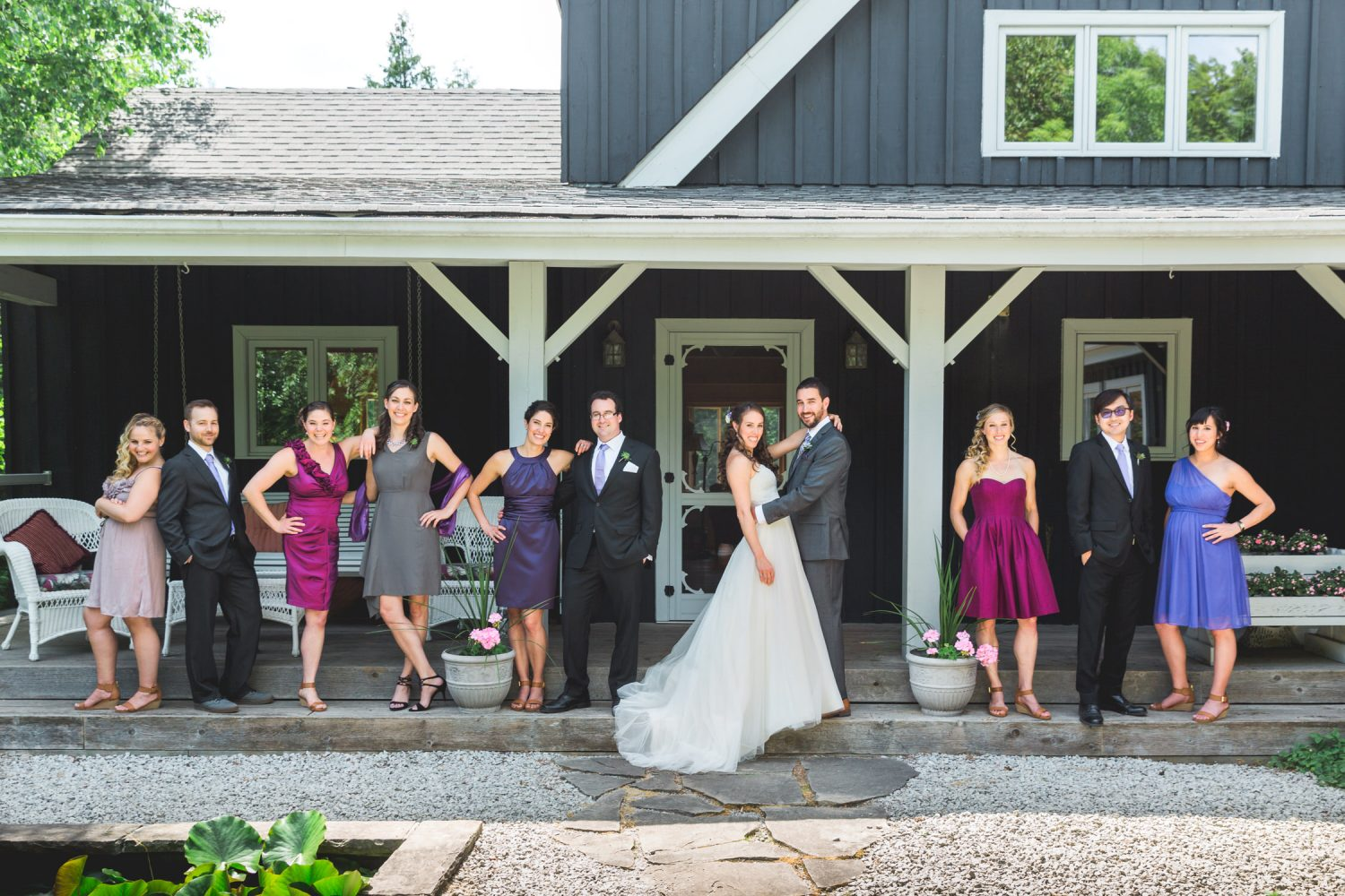 Wedding party GQ pose in front of house
