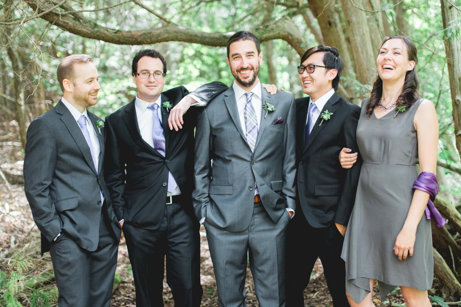 Groomsmen share a laugh with the groom