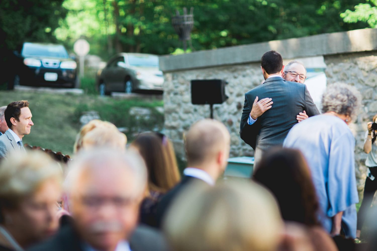 Groom shares a hug with father during ceremony