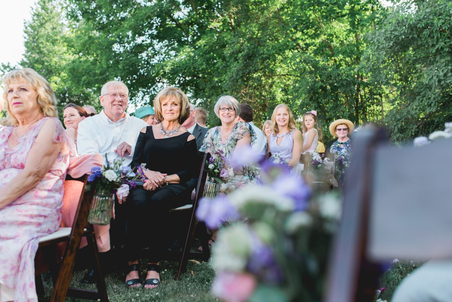 Guests watch wedding ceremony at Alton Mill