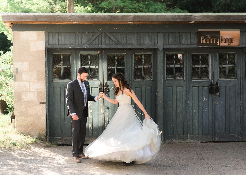 Bride and groom dance in front of garage door at Alton Mill