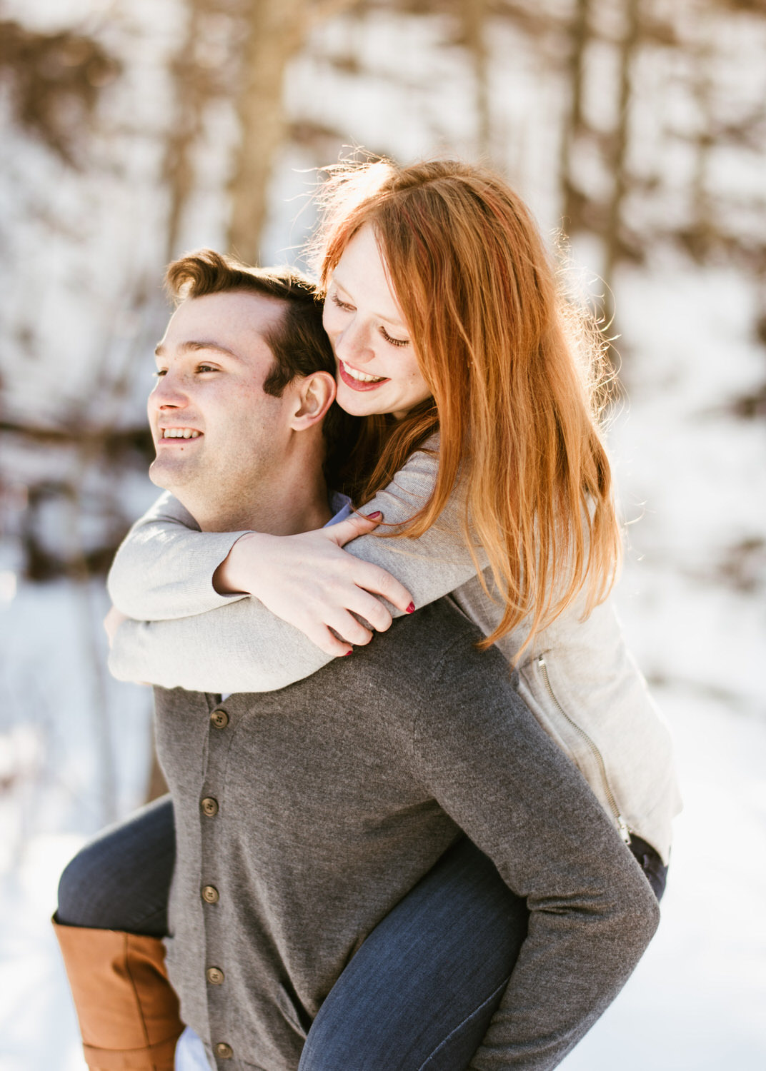 Matt piggybacking Isabel during engagement shoot